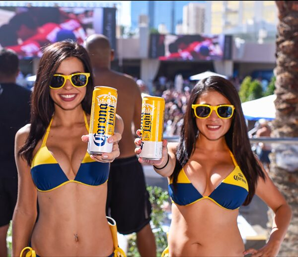 Two girls in a bikini holding drinks