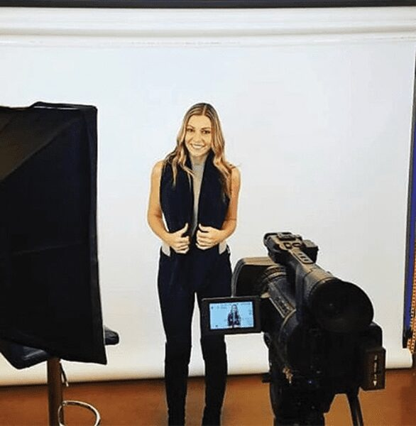 Woman posing in front of a camera