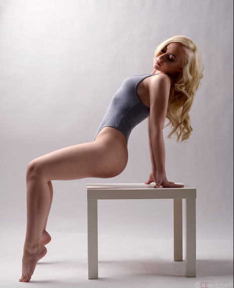 Blonde haired woman posing